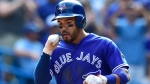 Toronto Blue Jays Devon Travis celebrates his two-run homer as he crosses home plate against the Washington Nationals during fifth inning interleague baseball action in Toronto on Saturday, June 16, 2018. THE CANADIAN PRESS/Frank Gunn