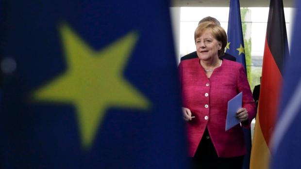 France, Germany agree to set up eurozone budget: Merkel