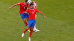 Serbia's Branislav Ivanovic, above, right, and Costa Rica's Oscar Duarte, left, and Giancarlo Gonzalez, front jump for the ball during the group E match between Costa Rica and Serbia at the 2018 soccer World Cup in the Samara Arena in Samara, Russia, Sunday, June 17, 2018. (AP Photo/Vadim Ghirda)