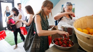 Joelle Kennedy shops for produce at Feed it Forward's Pay-what-you-can grocery store in Toronto, Ontario on Saturday, June 16, 2018. The new model grocery store, created by Chef Jagger Gordon is the first of it's kind in Toronto, encouraging those from different socioeconomic backgrounds to use and fuel the model to help curb food waste. THE CANADIAN PRESS/Cole Burston