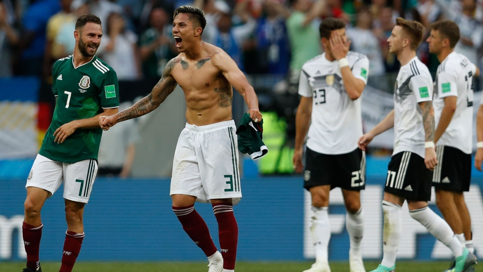 Mexico's Carlos Salcedo, second left, and Miguel Layun, left, react after Mexico defeated Germany in their group F match at the 2018 soccer World Cup in the Luzhniki Stadium in Moscow, Russia, Sunday, June 17, 2018. (AP Photo/Eduardo Verdugo)