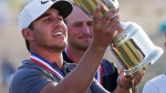 Brooks Koepka holds up the Golf Champion Trophy after winning the U.S. Open Golf Championship, Sunday, June 17, 2018, in Southampton, N.Y. (AP Photo/Seth Wenig)
