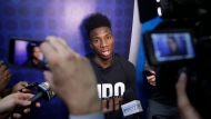 In this May 17, 2018, file photo, Hamidou Diallo, from Kentucky, speaks with the media at the NBA draft basketball combine, in Chicago. Most of the furniture was taken out of several rooms on the 15th and 16th floor of the hotel in downtown Chicago. There's a couple tables, a few chairs, and when the doors open to those suites draft hopefuls can make or break their futures in 20 minutes. This is where the interviews happen for the draft, where teams meet players and ask them about everything from their family histories to their thoughts on highway safety before investing millions of dollars. (AP Photo/Charles Rex Arbogast, FIle)