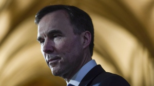 Minister of Finance Bill Morneau participates in a TV interview on Parliament Hill in Ottawa on February 27, 2018. THE CANADIAN PRESS/Justin Tang