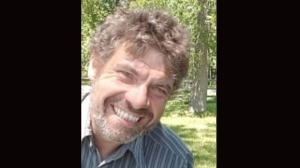 Raymond Moore, 42, is wanted in connection with the death of 51-year-old Joseph Perron. (Toronto Police Service handout)