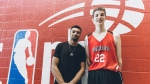 Denver Nuggets guard Jamal Murray, left, poses for a photo with Olivier Rioux, 12, in St. Catharines, Ont., in this recent handout photo. A grinning Denver Nuggets guard Jamal Murray posed for a selfie at last weekend's regional finals for the Jr. NBA world championship in St. Catharines, Ont., with a 12-year-old boy. Murray requested the selfie, not the other way around. Why? Because standing a sky-high six-foot-10, Olivier Rioux towers over the Canadian NBA player by seven inches. THE CANADIAN PRESS/HO - NBA