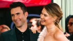In this Feb. 10, 2017, file photo, Adam Levine, left, and his wife Behati Prinsloo smile at a ceremony that honored him with a Star on the Hollywood Walk of Fame in Los Angeles. (Photo by Willy Sanjuan/Invision/AP, File)