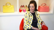 In this May 13, 2004, file photo, designer Kate Spade sits during an interview in New York. Kate Spade New York has announced plans to donate $1 million to support suicide prevention and mental health awareness causes in tribute to the company's late founder. The 55-year-old fashion designer killed herself June 5, 2018. Her husband says she suffered from depression and anxiety for many years. (AP Photo/Bebeto Matthews, File)