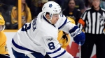 Toronto Maple Leafs defenseman Connor Carrick (8) passes the puck in front of Nashville Predators center Calle Jarnkrok (19), of Sweden, during the second period of an NHL hockey game Thursday, March 30, 2017, in Nashville, Tenn. (AP Photo/Mark Zaleski)