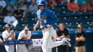 Duke's Griffin Conine (9) scores after a walk by Wake Forest pitcher Antonio Melendez in the 13th inning in the Atlantic Coast Conference NCAA college baseball tournament, Thursday, May 24, 2018, at Durham Bulls Athletic Park in Durham, N.C. (Robert Willett/The News & Observer via AP)