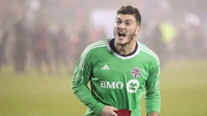 Toronto FC Alex Bono celebrates after the final whistle after defeating the New York Red Bulls on away goals to win the MLS Eastern Conference semifinal in Toronto on Sunday, November 5, 2017. Toronto FC goalkeeper Alex Bono knows Loris Karius' pain. Two costly flubs in the Champions League final have left the Liverpool 'keeper with haunting memories. THE CANADIAN PRESS/Chris Young