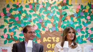 First lady Melania Trump, right, accompanied by Health and Human Services Secretary Alex Azar, left, speaks at a roundtable at the Upbring New Hope Children Center run by the Lutheran Social Services of the South in McAllen, Texas, Thursday, June 21, 2018. (AP Photo/Andrew Harnik)