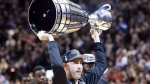 Toronto Argonauts quarterback Ricky Ray hoists the Grey Cup for fans after first quarter NBA basketball action between the Toronto Raptors and the Indiana Pacers, in Toronto on Friday, December 1, 2017. THE CANADIAN PRESS/Nathan Denette