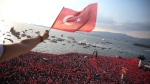 A man waves a Turkish flag as thousands of supporters of Muharrem Ince, the presidential candidate of Turkey's main opposition Republican People's Party, attend a rally in Izmir, Turkey, Thursday, June 21, 2018. Ince is seen as a strong contender to end President Recep Tayyip Erdogan's 16 year rule in presidential elections on June 24, 2018. (AP Photo/Emre Tazegul)