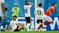 Egypt's defense watches disappointed after Russia's Artyom Dzyuba, right, scored his side's third goal during the group A match between Russia and Egypt at the 2018 soccer World Cup in the St. Petersburg stadium in St. Petersburg, Russia, Tuesday, June 19, 2018. (AP Photo/Martin Meissner)
