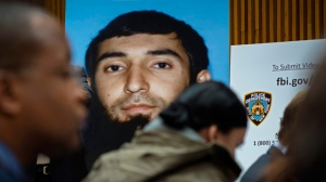 This Nov. 1, 2017, file photo shows a photo of Sayfullo Saipov displayed at a news conference at One Police Plaza in New York. In Manhattan federal court on Tuesday, Nov. 28, Saipov, who has been charged in a deadly truck rampage in New York City, pleaded not guilty to an indictment including multiple potential death-penalty counts. (AP Photo/Craig Ruttle, File)