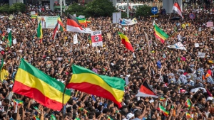 Ethiopians rally in solidarity with Prime Minister Abiy Ahmed in Meskel Square in the capital, Addis Ababa, Ethiopia Saturday, June 23, 2018. A deadly explosion struck the huge rally for Ethiopia's reformist new prime minister on Saturday shortly after he spoke and was waving to the crowd that had turned out in numbers unseen in recent years in the East African nation. (AP Photo/Mulugeta Ayene)