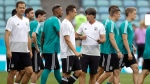 Germany head coach Joachim Loew, second right, talks to his players at the beginning of a training session of the German national soccer team on the eve of their Group F match against Sweden, during the 2018 soccer World Cup in Sochi, Russia, Friday, June 22, 2018. (AP Photo/Michael Probst)