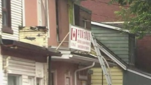 A ladder is seen near a window where a woman in her 50s was pulled from a burning house on June 23, 2018. (CP24)