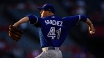 Toronto Blue Jays starting pitcher Aaron Sanchez throws to the plate during the first inning of the team's baseball game against the Los Angeles Angels on Thursday, June 21, 2018, in Anaheim, Calif. (AP Photo/Mark J. Terrill)