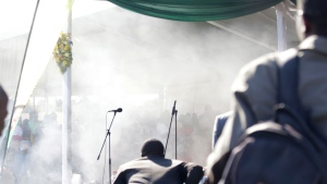 Smoke fills the stage following an explosion at a Zanu pf rally in Bulawayo, Saturday, June, 23, 2018. An explosion rocked a stadium where Zimbabwe's president was addressing a campaign rally on Saturday, with state media calling it an assassination attempt but saying he was not hurt and was evacuated from the scene. Witnesses said several people were injured, including a vice president. (AP Photo)