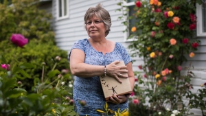 Wendy Gould holds the cremated remains of her late husband George Gould at her home, in Aldergrove, B.C., on Friday May 25, 2018. Wendy and George Gould were supposed to grow old together. But Wendy says their future was ripped away from them when George contracted a drug-resistant infection in a Vancouver hospital. During the final 18 months of his life, she says George was admitted to hospital 22 times for intravenous antibiotics that triggered violent nausea and frightening hallucinations. In January, he died in an isolation unit at age 58. THE CANADIAN PRESS/Darryl Dyck
