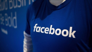 Guests are welcomed by people in Facebook shirts as they arrive at the Facebook Canadian Summit in Toronto on March 28, 2018.THE CANADIAN PRESS/Chris Donovan
