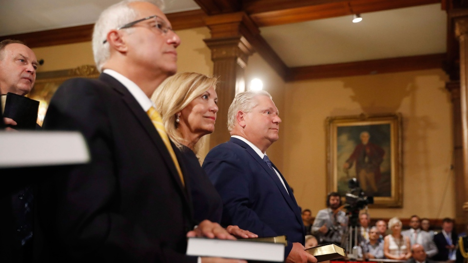 Doug Ford (right) Is Sworn In As Premier Of Ontario During A Ceremony At  Queenu0027s Park In Toronto On Friday, June 29, 2018. Cabinet Ministers  Christine ...