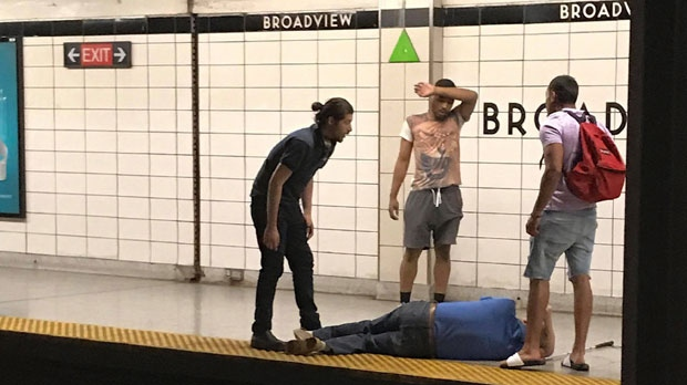 Three men look on after rescuing a blind man that had fallen onto the subway tracks at Broadview Station in Toronto on Thursday, June 28, 2018. A witness says bystanders rescued a blind man after he fell onto the subway tracks in Toronto on Thursday afternoon. Julie Caniglia says a man on her eastbound train leapt down to the tracks and crossed over to the westbound platform to help the blind man. THE CANADIAN PRESS/HO - Julie Caniglia