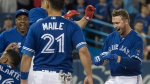 Toronto Blue Jays Justin Smoak (right) reaches home plate after hitting a walk-off home run to defeat the Detroit Tigers in their American League MLB baseball game in Toronto on Saturday, June 30, 2018. THE CANADIAN PRESS/Fred Thornhill