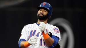 FILE - In this May 22, 2018, file photo, New York Mets' Jose Bautista (11) gestures to teammates after hitting a double during the second inning of a baseball game against the Miami Marlins, in New York. Bautista is a rare bright spot for the struggling Mets, still dangerous and productive at the plate. On deck this week is his first trip back to Toronto, where Bautista blossomed into one of baseball's best power hitters during nine-plus seasons with the Blue Jays. (AP Photo/Frank Franklin II, File)