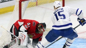 Ottawa Senators goaltender Craig Anderson (41) stops a shot by Toronto Maple Leafs forward Matt Martin (15) during second period NHL preseason hockey in Ottawa on Monday, September 18, 2017. THE CANADIAN PRESS/Fred Chartrand
