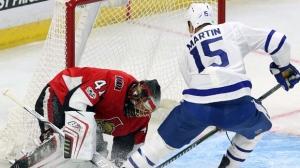 Ottawa Senators goaltender Craig Anderson (41) stops a shot by Toronto Maple Leafs forward Matt Martin (15) during second period NHL preseason hockey in Ottawa on Monday, September 18, 2017. THE CANADIAN PRESS/Fred Chartrand