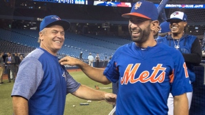 New York Mets' Jose Bautista spends a moment with his former manager, John Gibbons of the Toronto Blue Jays, at batting practice prior to the start of the Mets' Interleague MLB baseball game against the Blue Jays, in Toronto on Tuesday, July 3, 2018. THE CANADIAN PRESS/Fred Thornhill