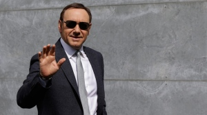 In this file photo dated Tuesday, June 21, 2016, actor Kevin Spacey waves as he arrives to attend the Giorgio Armani men's Spring-Summer 2016-2017 fashion show in Milan, Italy.  British police have disclosed Wednesday July 4, 2018, that they are now investigating six claims of alleged sexual assault or assault, by Academy Award-winning actor Kevin Spacey, three more than previously disclosed. (AP Photo/Luca Bruno, FILE)