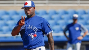Toronto Blue Jays relief pitcher Luis Santos reacts on the field during spring training baseball practice, Thursday, Feb. 22, 2018, in Dunedin, Fla. (AP Photo/John Minchillo)