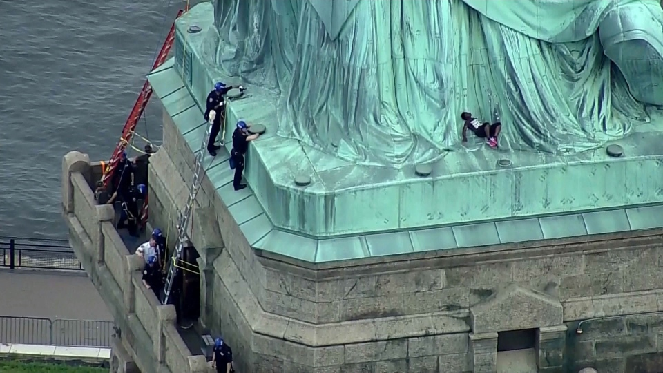 Satatue Of Liberty With Puartarican Flag Tattoo: Woman Climbs Statue Of Liberty To Protest U.S. Immigration