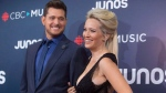 Michael Buble and wife Luisana Lopilato arrive on the red carpet at the Juno Awards in Vancouver, Sunday, March, 25, 2018. THE CANADIAN PRESS/Darryl Dyck