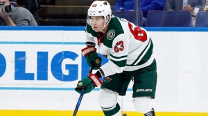 In this Nov. 25, 2017, file photo, Minnesota Wild's Tyler Ennis controls the puck during the first period of an NHL hockey game against the St. Louis Blues in St. Louis.  (AP Photo/Jeff Roberson, File)