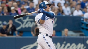 Toronto Blue Jays' Justin Smoak hits a three run home run against the New York Yankees in the second inning of their American League MLB baseball game in Toronto on Friday July 6, 2018. THE CANADIAN PRESS/Fred Thornhill