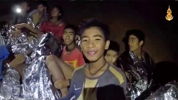 First boys emerge from cave