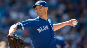 Toronto Blue Jays starting pitcher J.A. Happ works during first inning American League MLB baseball action against the New York Yankees, in Toronto on Saturday, July 7, 2018. THE CANADIAN PRESS/Fred Thornhill