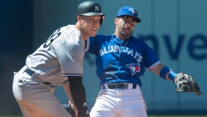 New York Yankees' Aaron Judge looks on as he's forced out at second base as Toronto Blue Jays second baseman Devon Travis turns the double play in the eighth inning of their American League MLB baseball game in Toronto on Sunday July 8, 2018. THE CANADIAN PRESS/Fred Thornhill