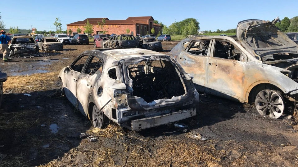 Burned-out vehicles sit in a field on Niagara Stone Road in Niagara-on-the-Lake  where a grass fire started Sunday July 8, 2018. (@NOTLfiredept /Twitter)