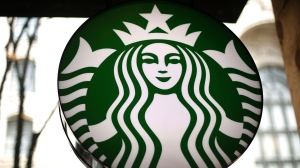 This March 24, 2018, file photo shows a sign in a Starbucks in downtown Pittsburgh. Starbucks is getting rid of plastic straws at its locations around the world. The coffee company said Monday, July 9, 2018, that it'll offer a strawless lid or straws made of paper or compostable material instead. (AP Photo/Gene J. Puskar, File)