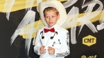 In this June 6, 2018, file photo, Mason Ramsey arrives at the CMT Music Awards at the Bridgestone Arena in Nashville, Tenn. Ramsey, a preteen Illinois boy who went viral online in a video of him singing and yodeling in a Walmart store is releasing his first album July 20. (AP Photo/Al Wagner, File)
