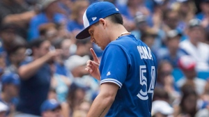 Toronto Blue Jays pitcher Roberto Osuna walks off the field after giving up three runs in a blown save and the win to the Los Angeles Angels in the ninth inning of their AL baseball game, in Toronto on Saturday July 29, 2017. THE CANADIAN PRESS/Fred Thornhill
