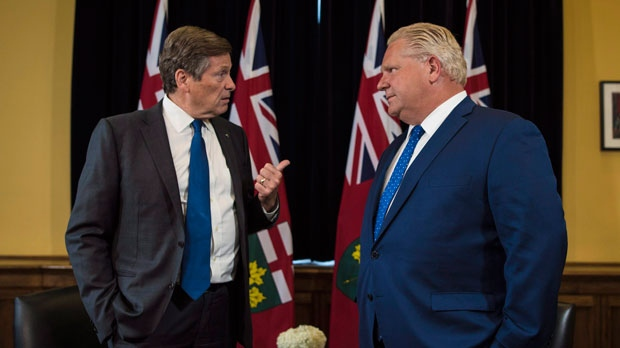 Ontario Premier Doug Ford and Toronto Mayor John Tory meet inside the Premier's office at Queen's Park in Toronto on Monday, July 9, 2018. THE CANADIAN PRESS/Tijana Martin