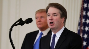 President Donald Trump listens as Judge Brett Kavanaugh his Supreme Court nominee speaks, in the East Room of the White House, Monday, July 9, 2018, in Washington. (AP Photo/Evan Vucci)