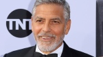 FILE - In this Thursday, June 7, 2018 file photo, George Clooney arrives at the 46th AFI Life Achievement Award Honoring himself at the Dolby Theatre in Los Angeles. Italian media say actor George Clooney has been hospitalized after he was involved in an accident while riding a motorcycle in Sardinia it was reported on Tuesday, July 10, 2018. (Photo by Willy Sanjuan/Invision/AP, File)